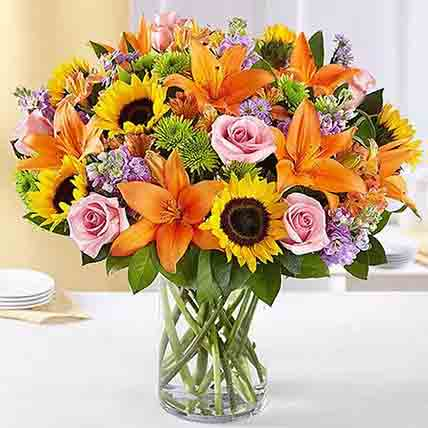 Vibrant Bunch of Flowers In Glass Vase: Sunflower Bouquet