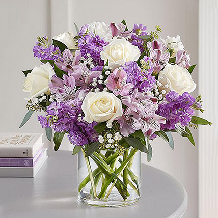 Purple and White Floral Bunch In Glass Vase: Wedding Flowers
