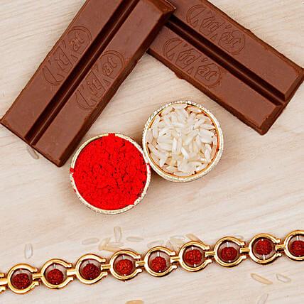 divine red rudraksha bracelet and 2 kitkat chocolates