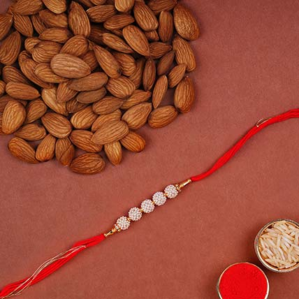 fancy golden pearl rakhi and almonds