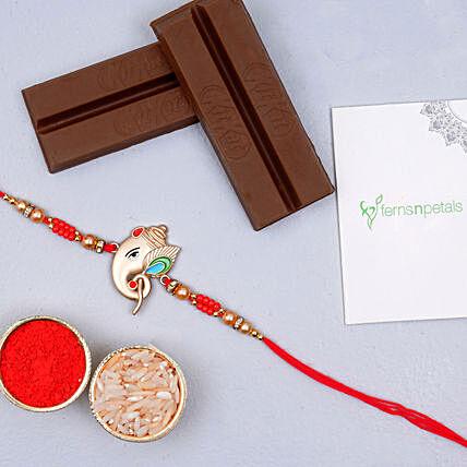 silver ganesha rakhi and 2 kitkat chocolates