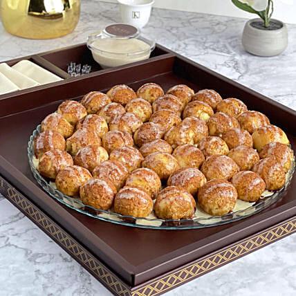 Cinnamon Balls With Cheesy Sauce